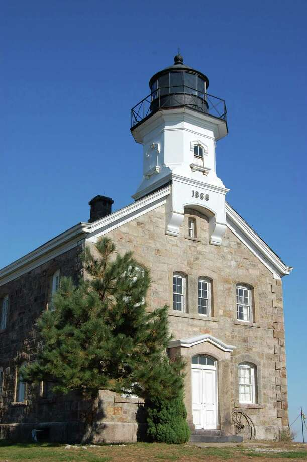 The Sheffield Island Lighthouse, located off shore from Norwalk, is a busy place each summer thanks to the multiple cruises run by the Norwalk Seaport Association. Photo: File Photo / Norwalk Citizen