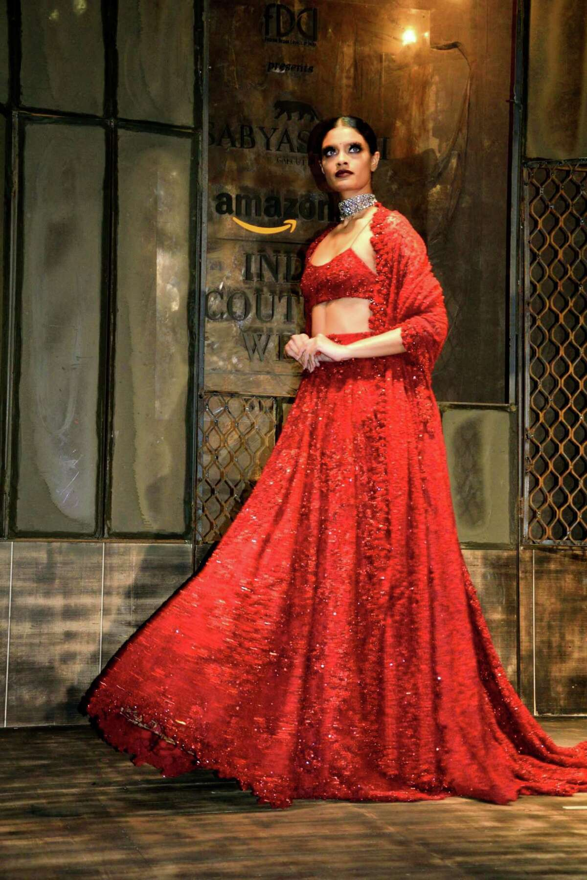 Indian fashion designer and couturier, Sabyasachi, opened the Fashion Design Council of India's (FDCI) Amazon India Couture Week 2015 in his quintessentially royal style with an artistic collaboration of flaming red soles by Lebanese shoe designer, Christian Louboutin, that lent glamour to his shimmering couture line at the Taj Palace Hotel in New Delhi, India.