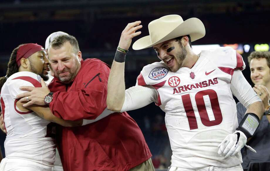 Arkansas quarterback Brandon Allen (10) tips a cowboy hat to teammates after winning the Texas Bowl NCAA college football game against Texas Monday, Dec. 29, 2014, in Houston. Allen won the Most Valuable Player award. Arkansas won 31-7. Photo: David J. Phillip /Associated Press / AP