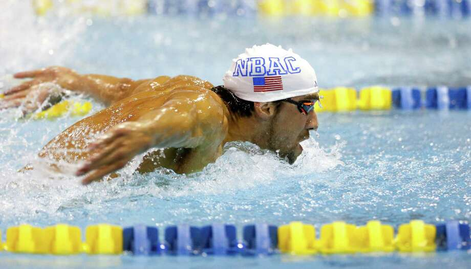 In this May 16, 2015, file photo, Micheal Phelps swims the 200-meter butterfly preliminary race at the Arena Pro Swim Series meet in Charlotte, N.C. The winningest athlete in Olympic history will be competing this week at the U.S. championships in San Antonio — basically, a backup meet for all those American swimmers who didn't qualify for the world championships in Kazan, Russia. Actually, Phelps did claim a spot on the team. But, after his second drunken driving arrest last September, USA Swimming issued a six-month suspension and took away his trip to Russia. Photo: Nell Redmond /Associated Press / FR25171 AP