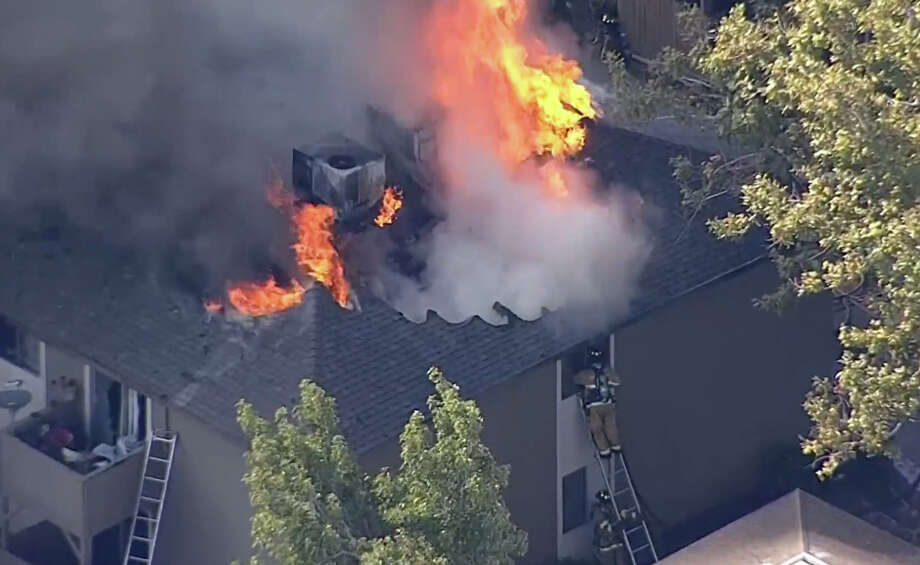 A three-alarm fire is burning Wednesday morning at the Delta Pines Apartments complex in Antioch. Photo: CBS San Francisco