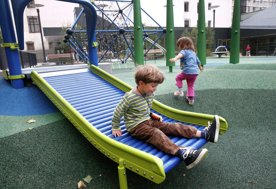 Huck Donovan, 5, and sister Theda, 2, have fun on the playground at Boedekker Park in the Tenderloin. Photo: Paul Chinn / Photos By Paul Chinn / The Chronicle / ONLINE_YES