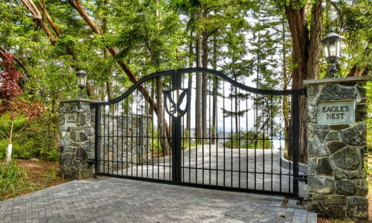 The gates to this five-bedroom Friday Harbor home show the estate's name,
