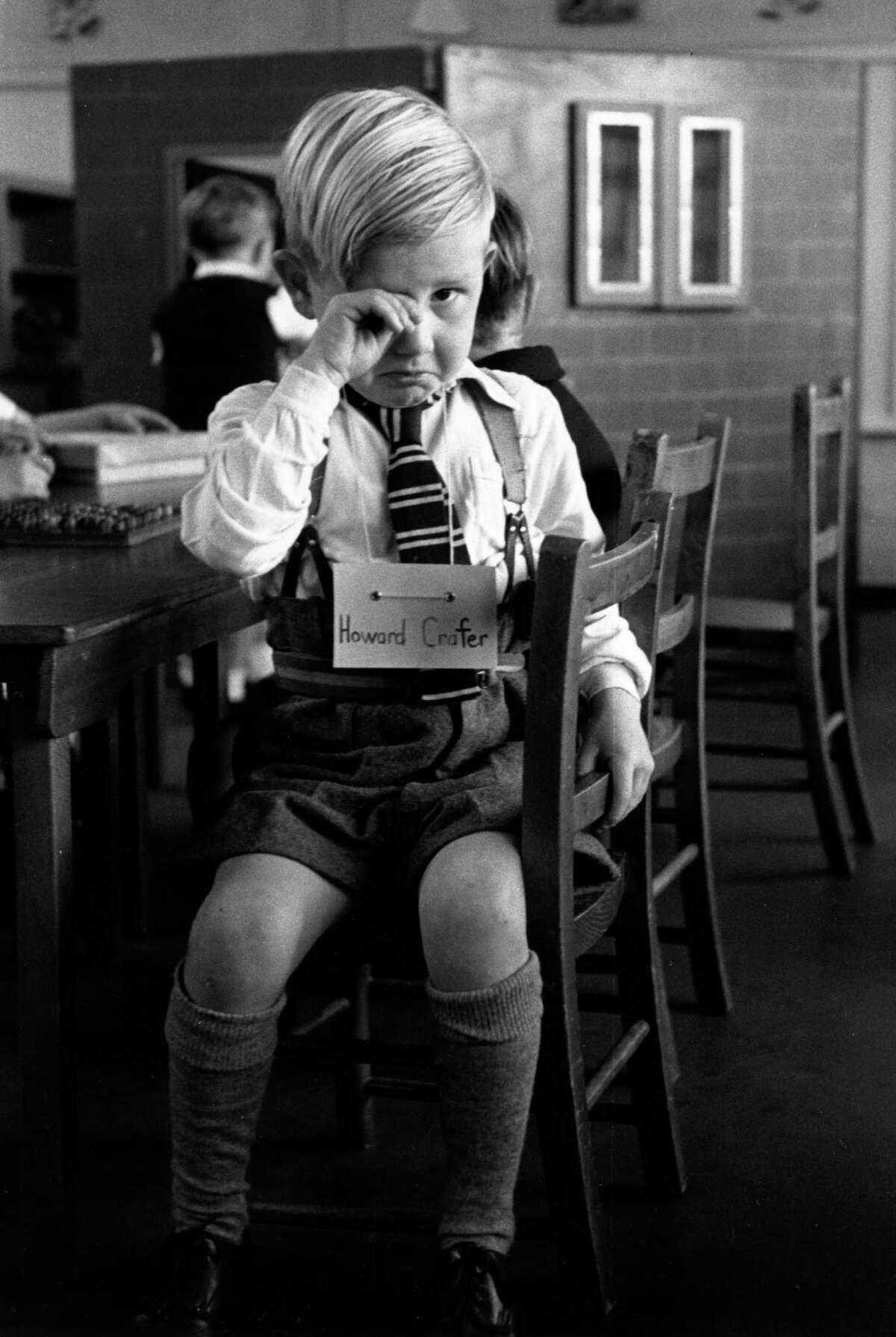 A five-year-old boy in tears on his first day at school at St Nicholas County Primary School in Loughton, Essex