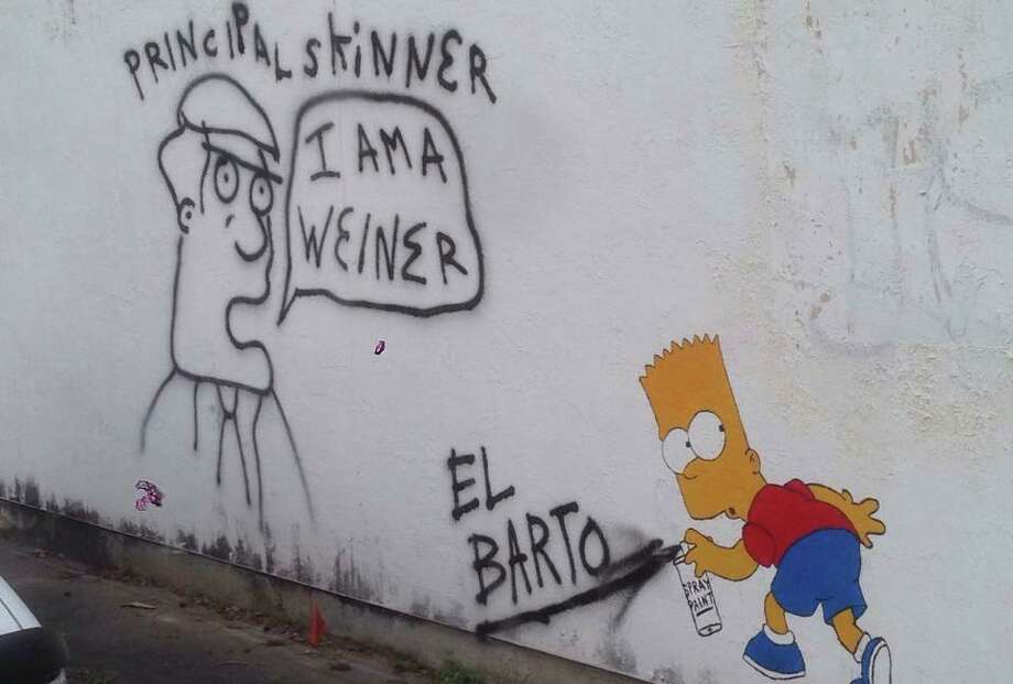 "For the past few months on downtown Houston's east side a small mural of sorts has been evolving at the corner of Saint Emanuel and Polk featuring characters from Fox's ""The Simpsons."" The ongoing art project is part of a viral marketing campaign from the owners of an upcoming music and comedy venue dubbed The Secret Group that owners hope to have open by the end of the year. Photo: The Secret Group"