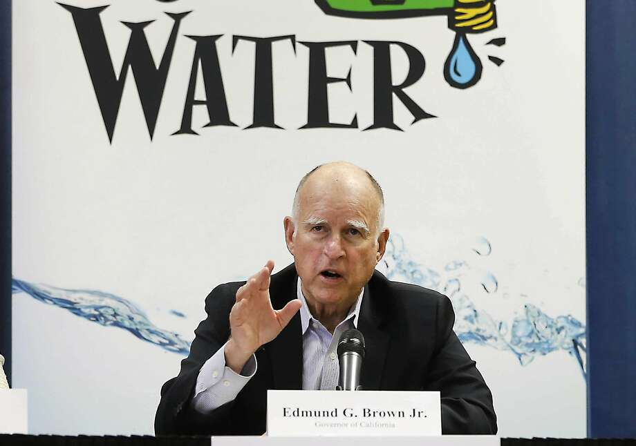 Gov. Jerry Brown talks with reporters after an April meeting about the drought at his Capitol office in Sacramento. Photo: Rich Pedroncelli, Associated Press