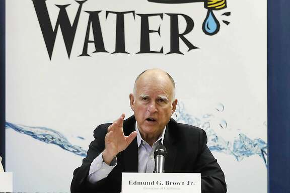 FILE - In this April 16, 2015 file photo, California Gov. Jerry Brown talks with reporters after a meeting about the drought at his Capitol office in Sacramento, Calif. When water gets scarce and the government slaps restrictions on its use, farmers should be first in line at the spigot, according to an Associated Press-GfK poll released Monday, Aug. 3, 2015. (AP Photo/Rich Pedroncelli, File)