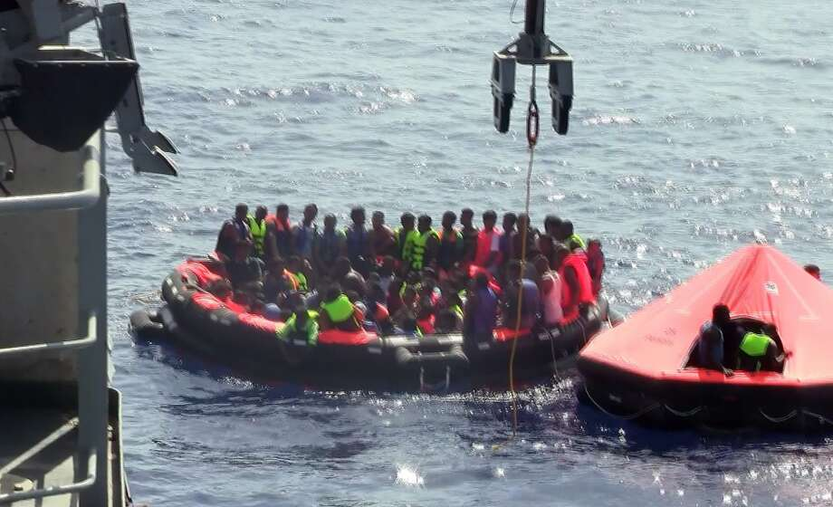 A video grab shows people in life rafts that were dispatched during a rescue operation after their overcrowded vessel capsized in the Mediterranean Sea. Photo: Irish Defence Forces, AFP / Getty Images