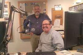 "Dante Betteo, standing, general manager at KCSM radio, with DJ Jesse ""Chuy"" Varela."