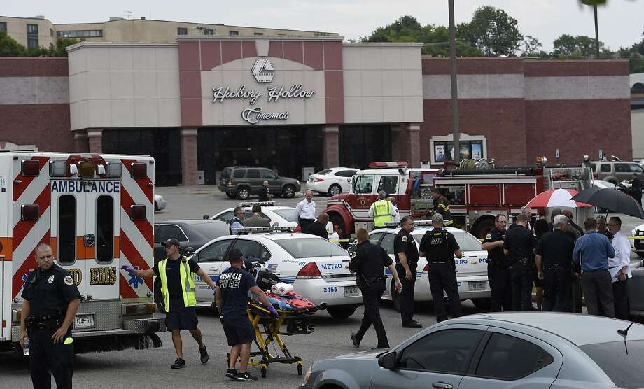 Emergency responders work in the parking lot of a Nashville-area movie theater after a 51-year-old man exchanged gunshots with SWAT team members. Photo: Mark Zaleski, Associated Press