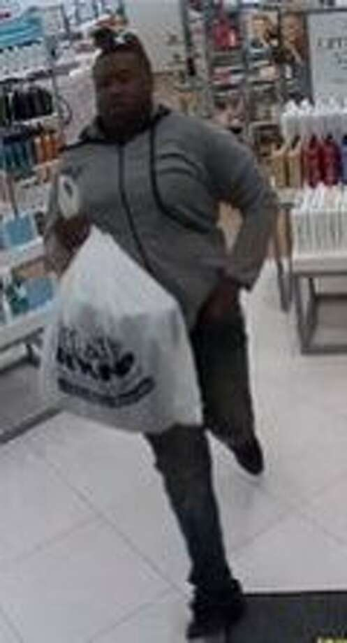 Investigators are looking for nine suspects, including the person pictured here, who stole more than $11,000 worth of high-end perfume in a smash-and-grab style heist in San Francisco July 28, 2015. Photo: Courtesy, San Francisco Police Department