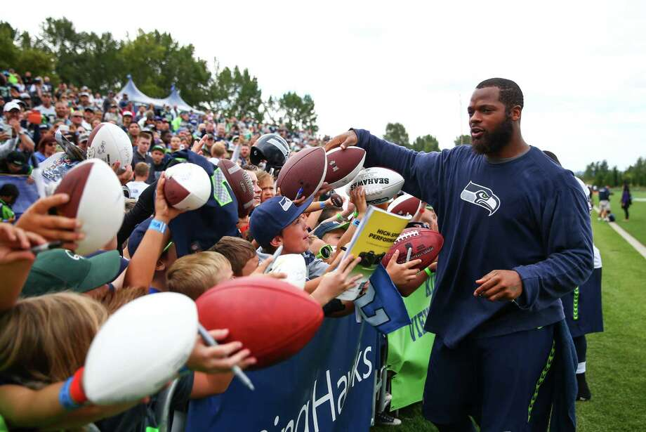 Michael Bennett signs autographs during Seahawks training camp. Photographed on Wednesday, August 5, 2015 at the Virgina Mason Athletic Facility in Renton. Photo: JOSHUA TRUJILLO, SEATTLEPI.COM / SEATTLEPI.COM