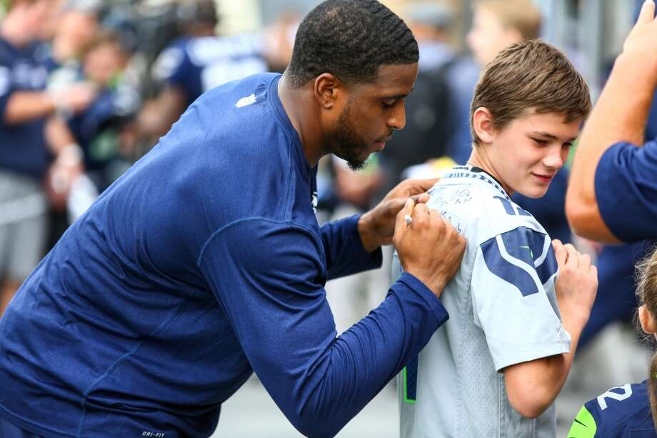 Seahawks player Bobby Wagner signs an autograph during Seahawks training camp. Photographed on Wednesday, August 5, 2015 at the Virgina Mason Athletic Facility in Renton. (Joshua Trujillo, seattlepi.com) Photo: JOSHUA TRUJILLO, SEATTLEPI.COM