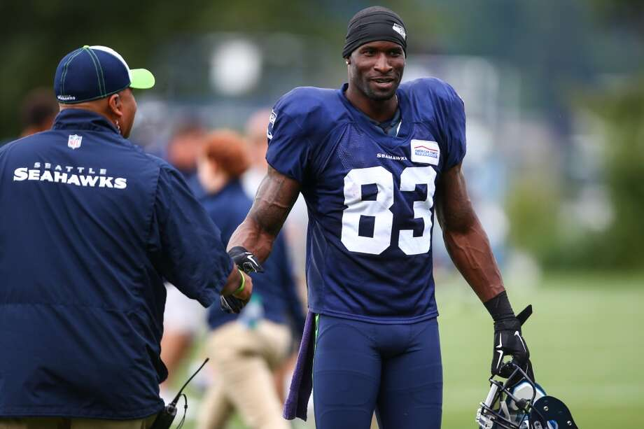 Ricardo Lockette shakes hands with a team staff member during Seahawks training camp. Photographed on Wednesday, August 5, 2015 at the Virgina Mason Athletic Facility in Renton. (Joshua Trujillo, seattlepi.com) Photo: JOSHUA TRUJILLO, SEATTLEPI.COM