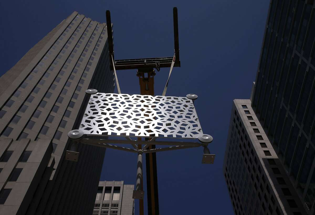 One of the prototype panels that will cover the exterior of the Transbay Transit Center is displayed in downtown San Francisco, Calif., on Wed. August 5, 2015. The surface had a built in reflective surface in the white paint covering.