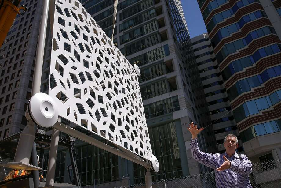 Darin Cook, senior associate principal with Pelli Clarke Pelli Architects with one of the prototype panels that will cover the exterior of the Transbay Transit Center in downtown San Francisco, Calif., as seen on Wed. August 5, 2015. Photo: Michael Macor, The Chronicle