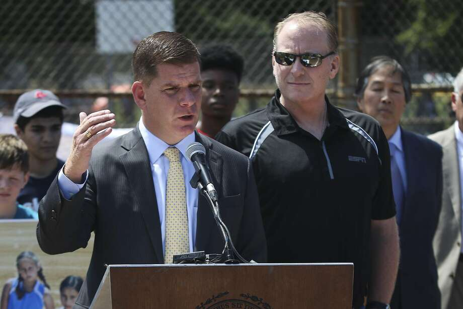Boston Mayor Martin J. Walsh, joined by former Boston Red Sox pitcher Curt Schilling, speaks during a press conference, Wednesday, Aug 5, 2015, about his proposal to ban snuff and chewing tobacco in city ballfields, including Fenway Park. (Harrison Hill/The Boston Globe via AP)  BOSTON HERALD OUT, QUINCY OUT; NO SALES; MANDATORY CREDIT Photo: Harrison Hill, Associated Press