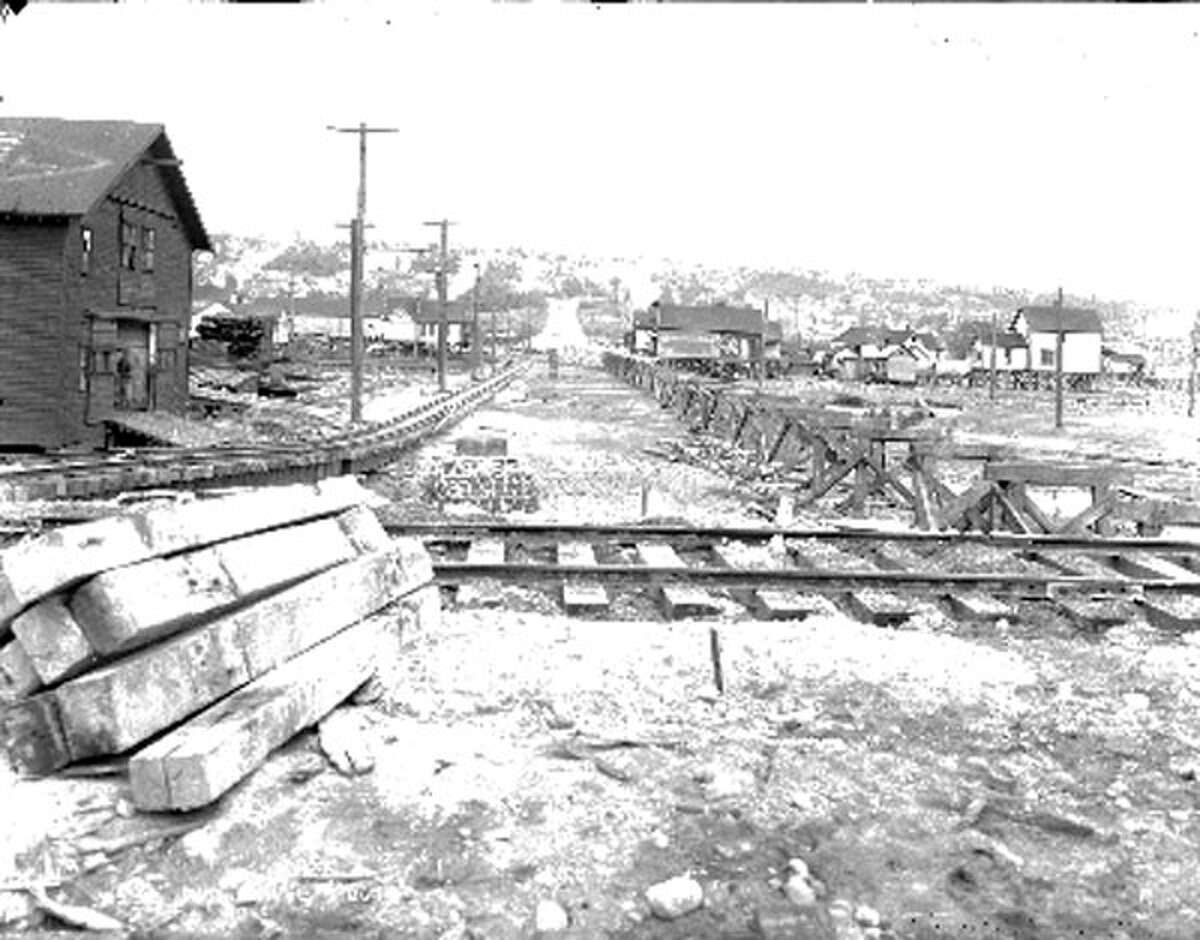 This photo from June 26, 1914 shows regrading work in Ballard, looking east on 47th Street. Much of Seattle went through regrades, including Capitol Hill, First Hill, Beacon Hill and Denny Hill, which was about where Belltown now sits.