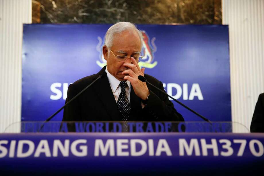 Malaysian Prime Minister Najib Razak, announces the findings for Flight 370, missing since last March, in Kuala Lumpur, Malaysia, early Thursday.  Experts have confirmed that the debris found on Reunion Island last week was that of Malaysian Airlines flight 370 that went missing last year, Malaysia's prime minister said early Thursday. (AP Photo/Vincent Thian) Photo: Vincent Thian, STF / AP