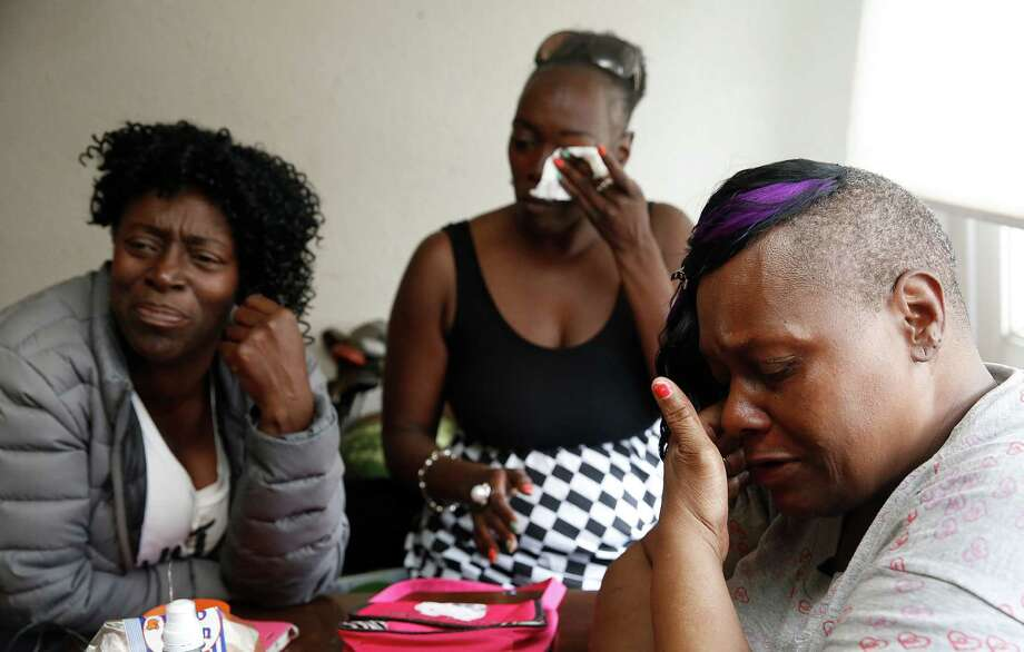 Left to right--Sister Yvonne Fletcher, 51 years old, niece Tasha Dillard, 40 years old, and sister Effie Haynes , 59 years old, at home in San Francisco, Calif., on Friday, July 31, 2015, as they show pictures and talk about  Alvin Haynes , a 57-year-old inmate, who died at a San Francisco jail in San Bruno earlier this year.  Family members were told his cause of death was heart failure, but Haynes' body was returned covered with bruises. Photo: Liz Hafalia / The Chronicle / ONLINE_YES