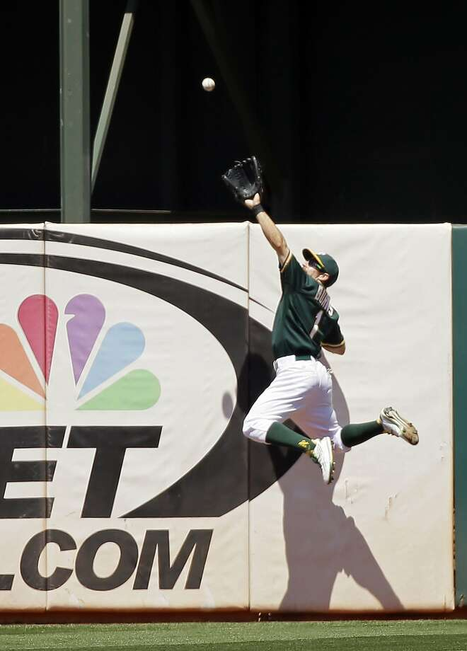 Oakland Athletics center fielder Billy Burns makes a leaping catch at the wall on a fly ball hit by the Baltimore Orioles' Adam Jones during the sixth inning of a baseball game, Wednesday, Aug. 5, 2015, in Oakland, Calif. (AP Photo/Eric Risberg) Photo: Eric Risberg, Associated Press