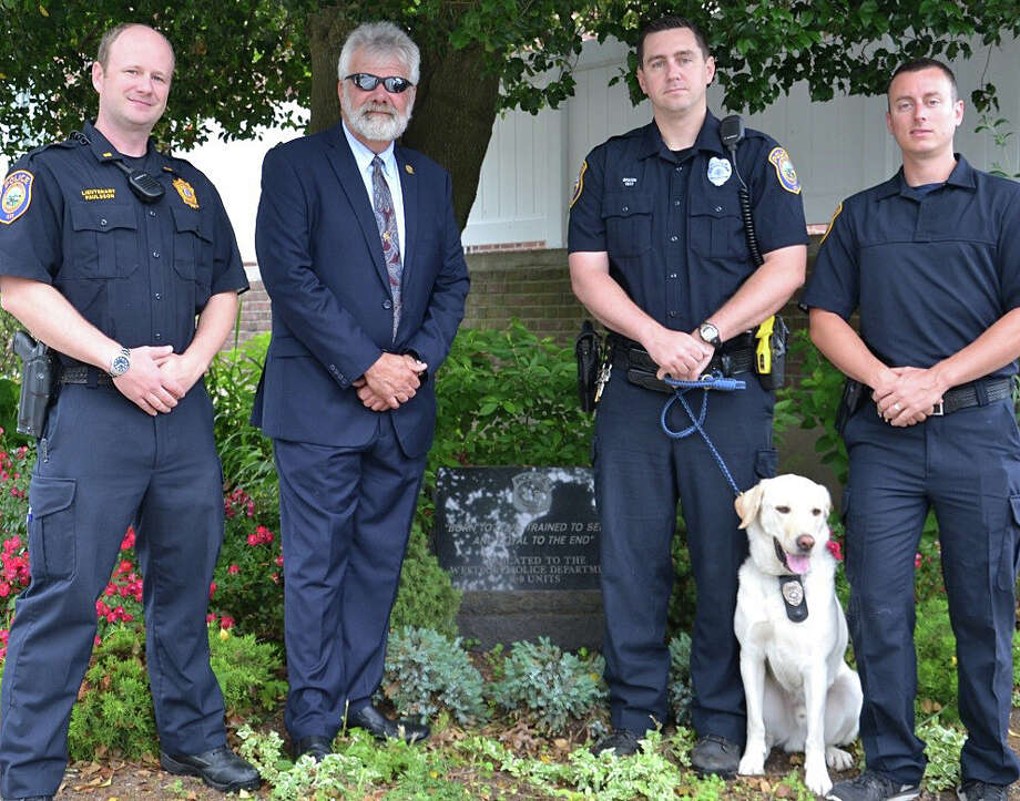 Chris Sweetwood, second from left, a member of the Trap Falls Kennel Club, was thanked recently by members of the Police Department's K-9 unit for helping support its acquistion and training of its new K-9, Chase, a 2-year-old Labrador retriever. Also pictured are Lieut. Lieutenant Ryan Paulsson and Officers James Baker and Brendan Fearon. Photo: Contributed / Contributed Photo / Westport News