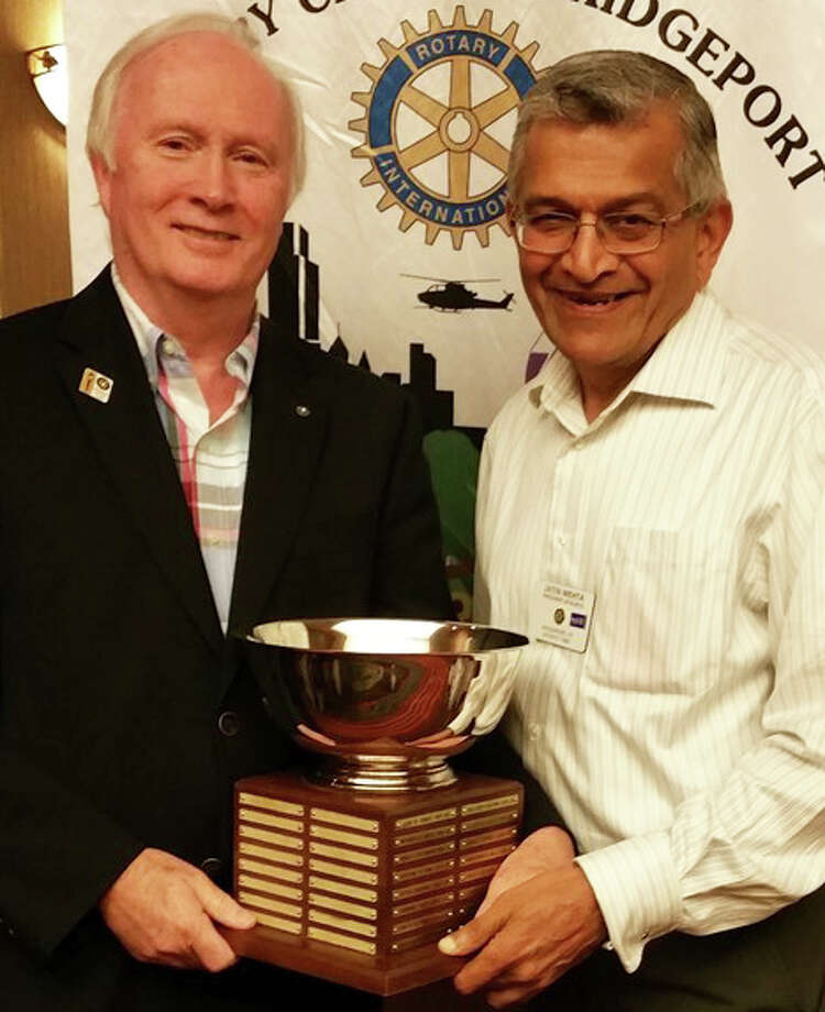 Philip Dwyer, left, of Fairfield, receives the Rotarian of the Year award from Jatin Mehta, president of the Rotary Club of Bridgeport. Photo: Contributed Photo / Fairfield Citizen