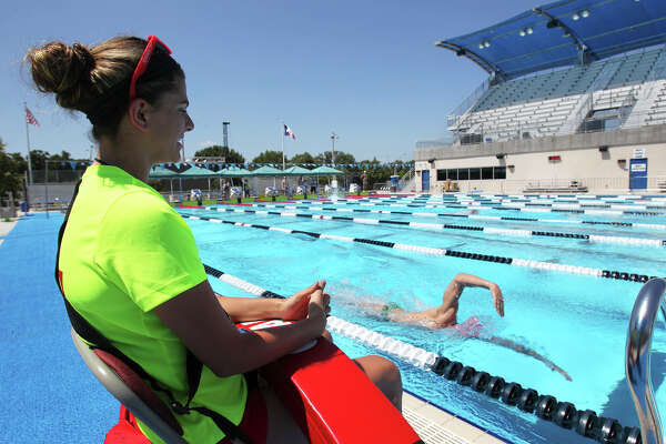 Lifeguard Sara Schmachtenberger  watches swimmers  working out at the Northside Swim Center on Wednesday, August 5, 2015 in preparation for the Phillips 66 Nationals.