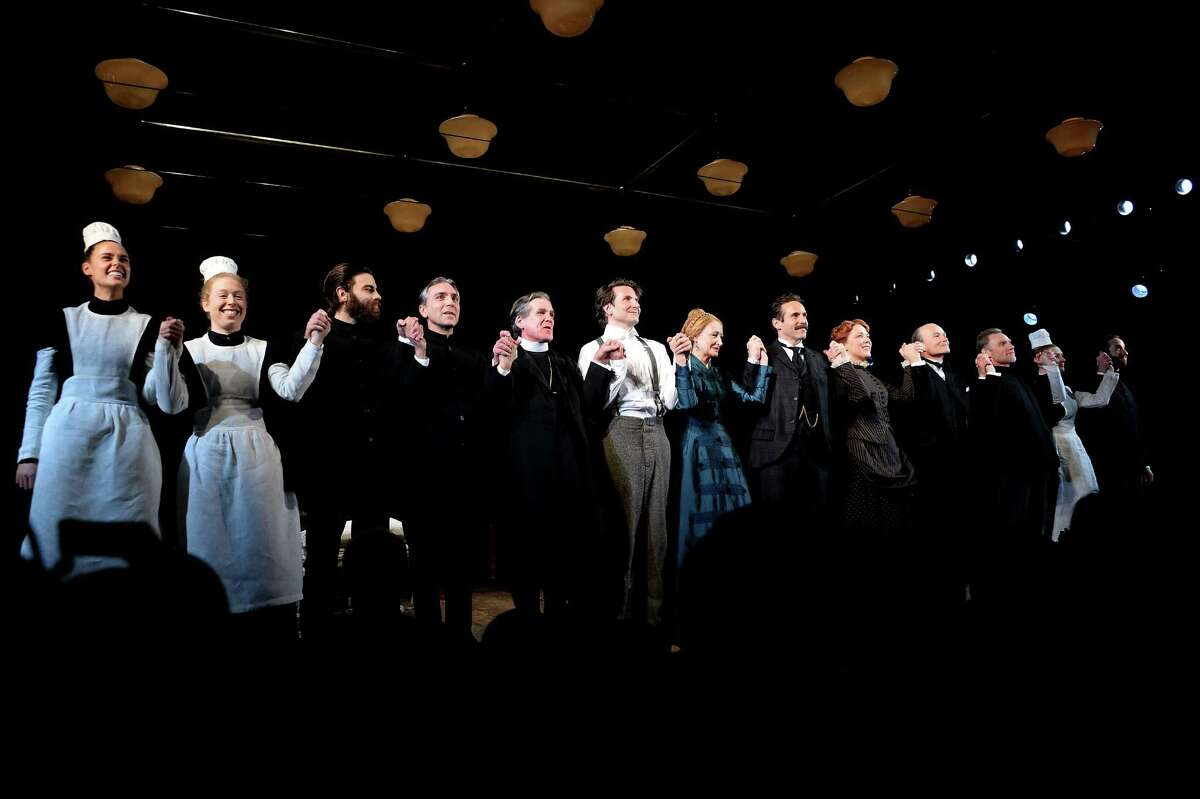 """Bradley Cooper (center), Amanda Lea Mason (second from left) and other cast members of """"The Elephant Man"""" held hands on Broadway on opening night, Dec. 7, at the Booth Theater in New York City."""
