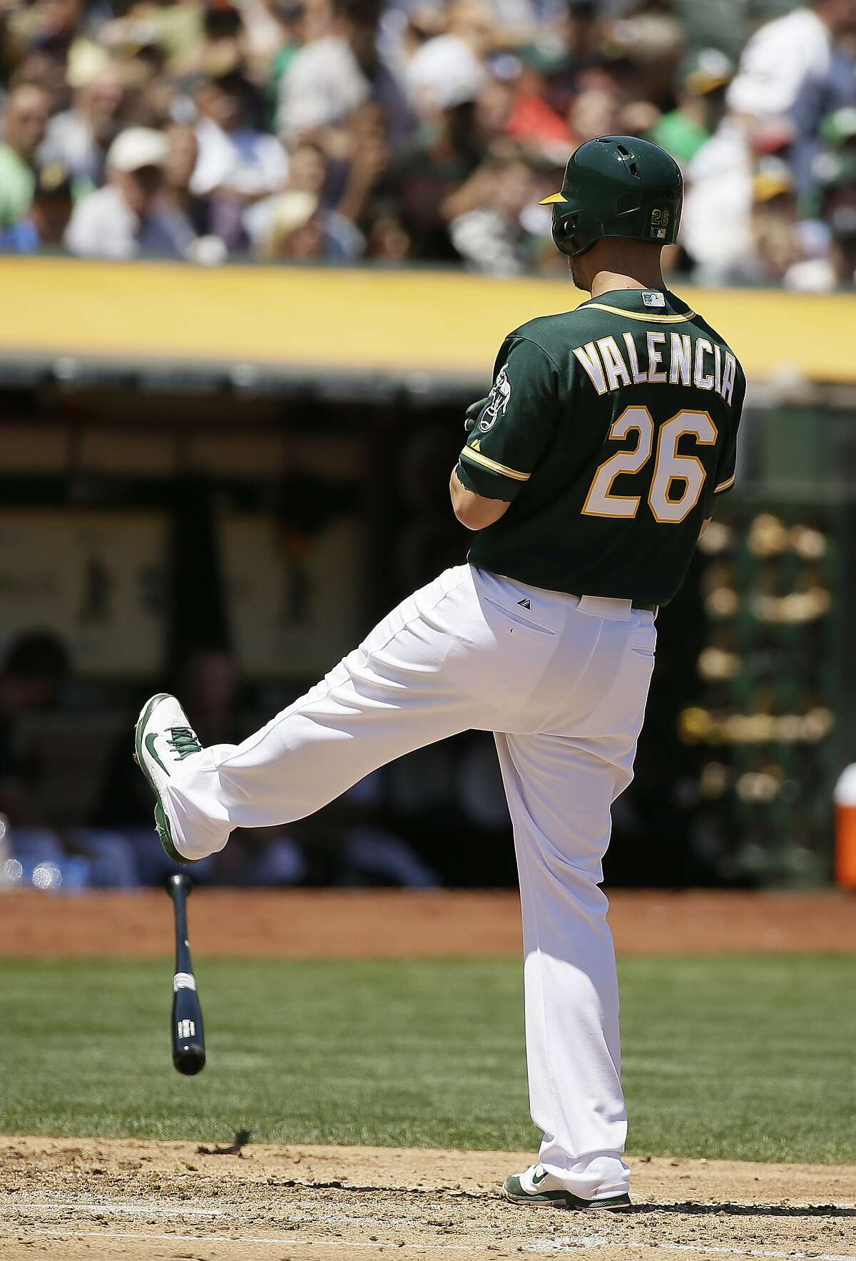 Oakland Athletics' Danny Valencia reacts after striking out with the bases loaded in the third inning of their baseball game against the Baltimore Orioles Wednesday, Aug. 5, 2015, in Oakland, Calif. (AP Photo/Eric Risberg)