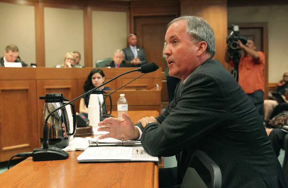 In this July 29, 2015 photo, Texas Attorney General Ken Paxton appears before the Senate Health and Human Services Committee in Austin, Texas. Attorney Genera Paxton has been ordered to appear Thrusday in a San Antonio Federal Courtroom by Judge Orlando Garcia on contempt charges related to the Federal ruling on gay marriage. Photo: Tom Reel /San Antonio Express-News