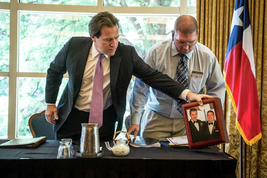 John Allen Stone-Hoskins, right, and his lawyer Neel Lane hold a press conference at the Westin in San Antonio to discuss their recent filing of a motion to amend the death certificate of Hoskins' late husband, James Stone-Hoskins, to reflect the legitimacy of John and James's marriage by including his title as remaining spouse on the certificate on Wednesday, August 5, 2015. Photo: Matthew Busch, For San Antonio Express-News / For San Antonio Express-News / © Matthew Busch