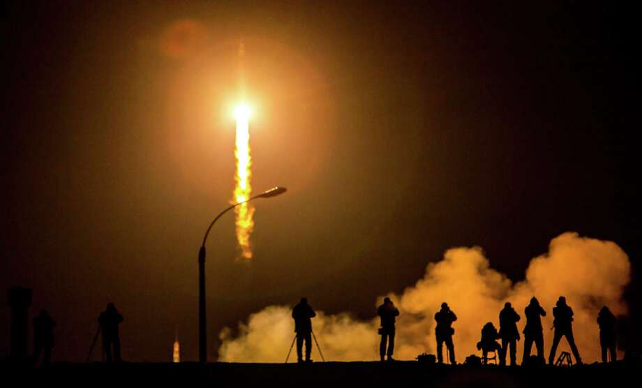 Russia's Progress M-28M cargo ship launches on July 3 from the Baikonur cosmodrome in Kazakhstan.  The ship takes off for the International Space Station (ISS) after a series of high-profile failures that have delayed the next manned flight to the orbiting outpost. AFP PHOTO / STRINGERSTRINGER/AFP/Getty Images Photo: Bill Ingalls/NASA, Handout / 2015 NASA