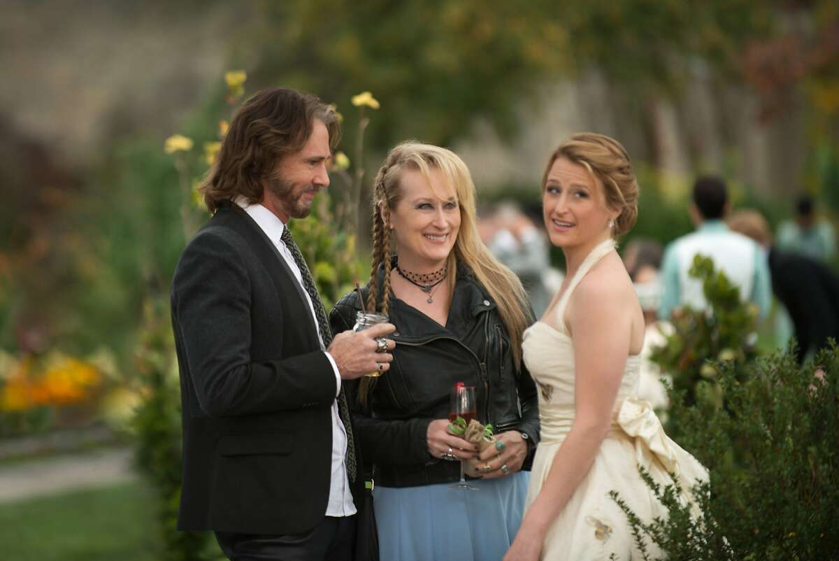 """This photo provided by courtesy of Sony Pictures shows, Rick Springfield, from left, as Greg, Meryl Streep, as Ricki, and Mamie Gummer as Julie, in TriStar Pictures' """"Ricki and the Flash."""" The movie opens in U.S. theaters on Aug. 7, 2015. (Bob Vergara/Sony Pictures via AP)"""