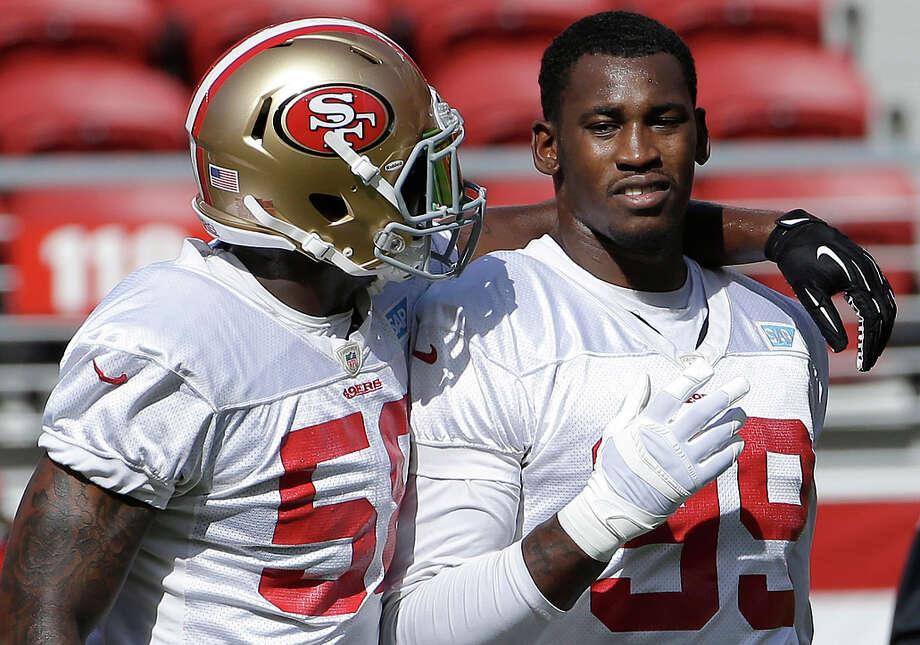 Aldon Smith talk during the team's NFL football training camp in Santa Clara, Calif., Sunday, Aug. 2, 2015. (AP Photo/Jeff Chiu) Photo: Jeff Chiu / Associated Press / AP