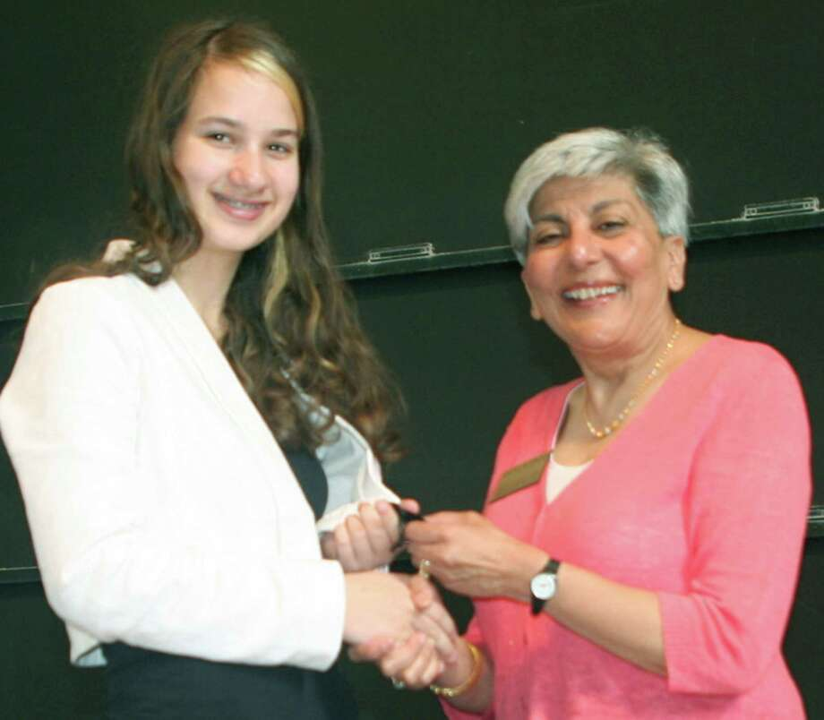 Maya Theodoros, 14, of Sherman is honored by Neetu Dhawan-Gray, assistant director of the Johns Hopkins University Center for Talented Youth. Photo: Contributed Photo / The News-Times Contributed