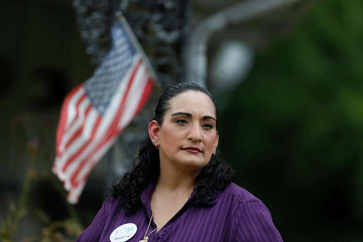 Patricia Gonzales has two small American flags in front of her Pasadena home. She has been involved in ongoing battles surrounding voting rights. One challenges Pasadena's 3-year-old system for electing city council candidates, which some contend dilutes the political influence of the city's growing Hispanic population.