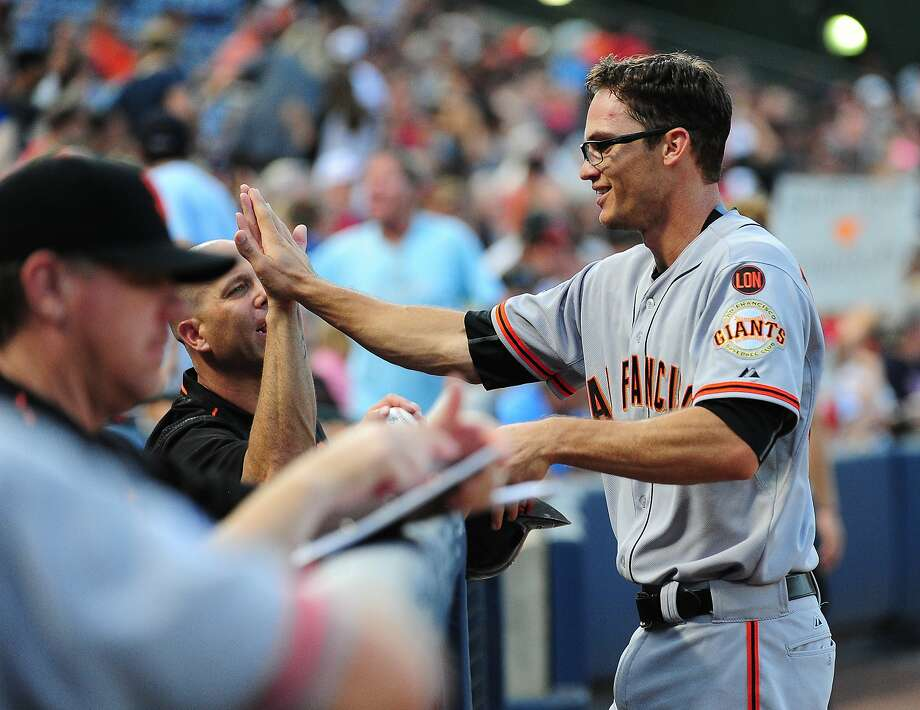 ATLANTA, GA - AUGUST 5: Kelby Tomlinson #37 of the San Francisco Giants is congratulated by Tim Hudson #17 after knocking in two runs with a second inning single against the Atlanta Braves at Turner Field on August 5, 2015 in Atlanta, Georgia. (Photo by Scott Cunningham/Getty Images) Photo: Scott Cunningham, Getty Images