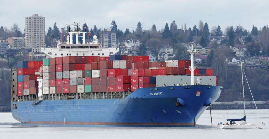 The 925-foot-long HS Mozart cargo ship, operated by the German company Hansa Shipping, is anchored near Tacoma, Wash.  Photo: Ted S. Warren, STF / AP