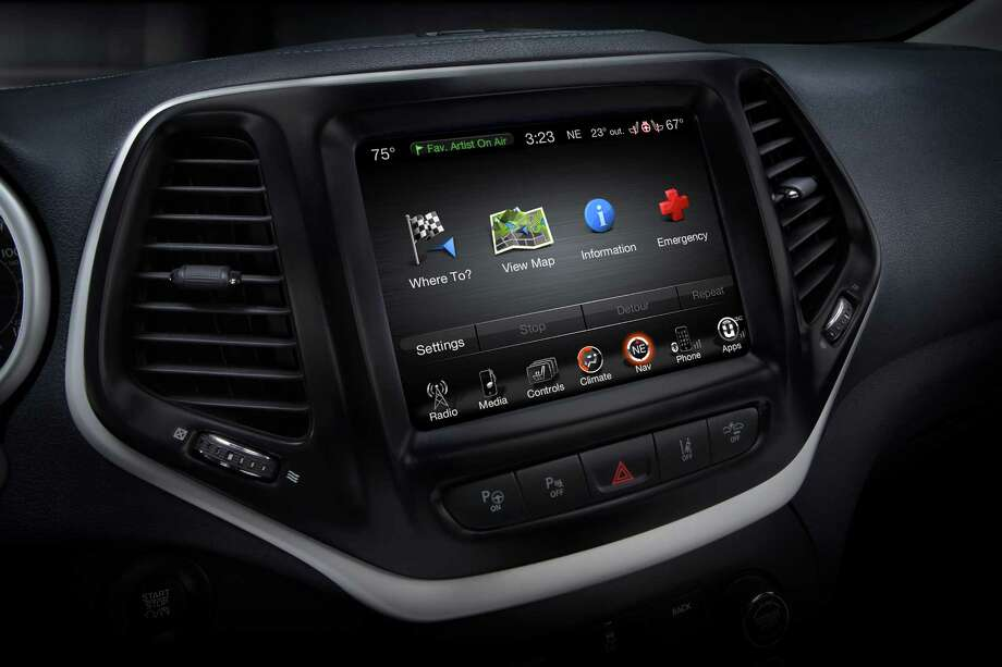 This product image provided by Fiat Chrysler Automobiles (FCA) shows the Uconnect 8.4 inch infotainment system on a 2014 Jeep Cherokee Limited. FCA on Wednesday, Aug. 5, 2015 said that it has a software fix that will prevent future hacking into the Jeep Cherokee and other vehicles. Owners of some 2013 and 2014 model year vehicles with 8.4-inch touchscreen infotainment systems can download the software from FCA's UConnect Web site and install it on their vehicles. (Fiat Chrysler Automobiles via AP) Photo: Uncredited, HONS / FCA