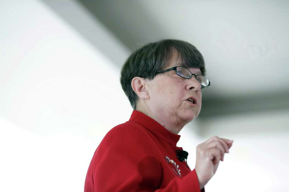 FILE - Mary Jo White, Chairwoman of the Securities and Exchange Commission speaks in New York, June 5, 2014. After a long delay and plenty of pushback from corporate America, the SEC will require most public companies to regularly reveal the gap between the compensation of the chief executive and the rest of their employees, the agency announced on Aug. 5, 2015. (Michael Appleton/The New York Times) Photo: MICHAEL APPLETON, STR / NYTNS