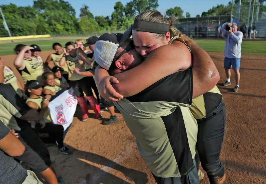 McKenzie Neumann Seguin Majors' McKenzie Neumann (99) gets a hug from her father, Ernest Neumann, Jr., after Seguin defeated Greater Helotes in the championship game of the 2015 Little League Softball Southwest Region Tournament in Waco on Wednesday, Aug. 5, 2015. Seguin held off Helotes to win, 6-4, and moves on to play in the World Series tournament in Portland, Oregon. (Kin Man Hui/San Antonio Express-News) Photo: Kin Man Hui / San Antonio Express-News / ©2015 San Antonio Express-News