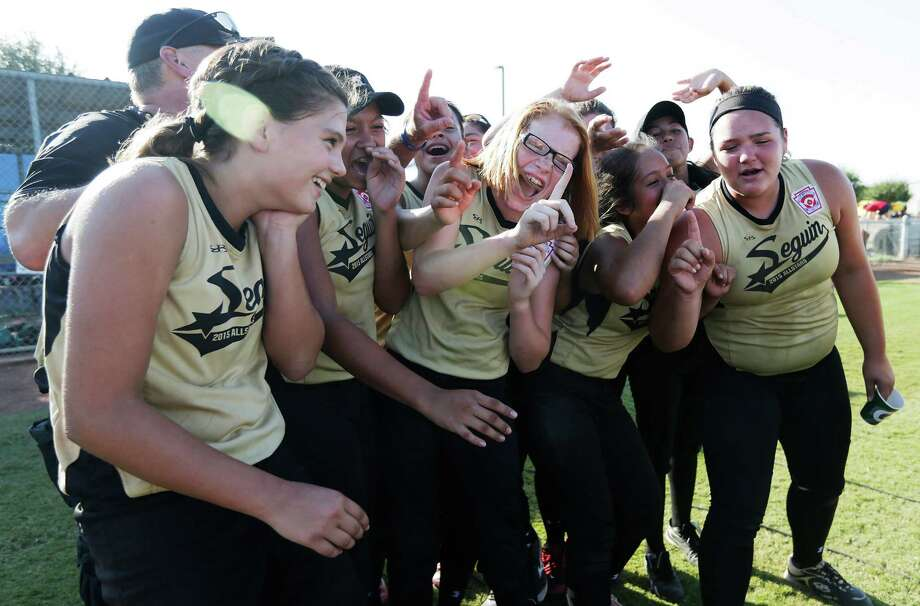 The Seguin all-stars defeated Helotes on Aug. 5 to advance to the Little League Softball World Series. The city celebrated with a pep rally Sunday. Photo: Kin Man Hui / San Antonio Express-News / ©2015 San Antonio Express-News