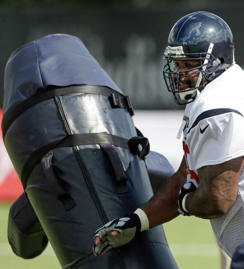 Nose tackle Vince Wilfork gets up close and personal with a blocking dummy during Wednesday's practice at training camp. Photo: Brett Coomer, Staff / © 2015 Houston Chronicle