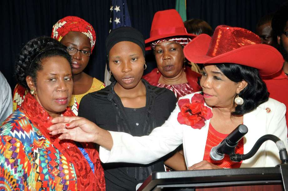 U.S. congresswomen, Frederica Wilson , left, and Sheila Jackson Lee speak at a news conference at the U.S embassy in Abuja, Nigeria, on Tuesday.  Wilson and Jackson Lee said Nigeria's #BringBackOurGirls campaign must hold every single newly elected official responsible for the freedom of scores of schoolgirls kidnapped by Boko Haram extremists more than 15 months ago.  (AP Photo/Olamikan Gbemiga) Photo: Olamikan Gbemiga, STR / AP