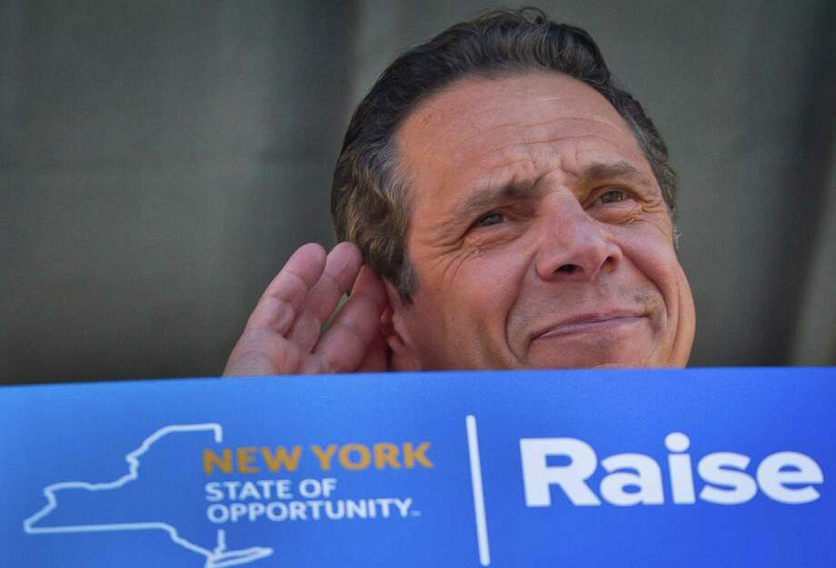Gov. Andrew Cuomo listens during a labor rally announcing a plan to get a minimum  $15 an hour wage hike for fast-food workers, Thursday, May 7, 2015, in New York. (AP Photo/Bebeto Matthews) Photo: Bebeto Matthews / AP