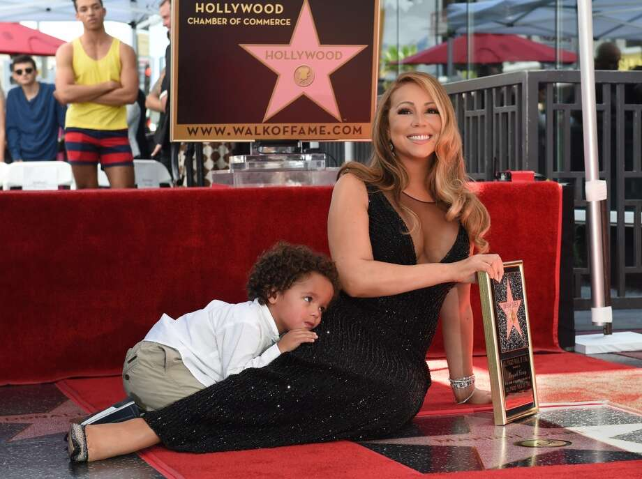 Singer Mariah Carey with son Moroccan Cannon is honored with the 2,556th star on The Hollywood Walk of Fame in Hollywood, California on August 5, 2015.  Mariah Carey is the best-selling female artist of all time with more than 200-million albums sold so far and 18 Billboard Hot 100 No. 1 singles.                 AFP PHOTO/MARK RALSTONMARK RALSTON/AFP/Getty Images Photo: MARK RALSTON, AFP / Getty Images