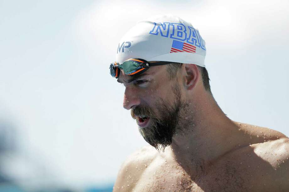 Sporting a beard, Michael Phelps, 30, looked the part of a swimming veteran as he worked out Wednesday at the Northside Swim Center in San Antonio. Photo: Eric Gay, STF / AP