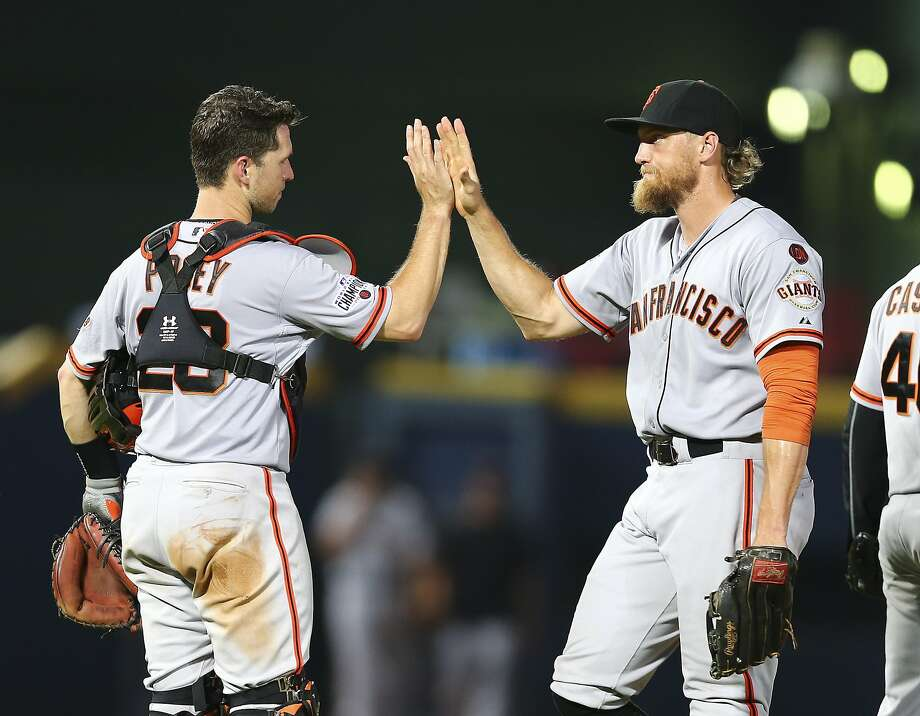 San Francisco Giants catcher Buster Posey, left, and San Francisco Giants right fielder Hunter Pence celebrate after defeating the Atlanta Braves 6-1in a baseball game, Wednesday, Aug. 5, 2015, in Atlanta. (AP Photo/John Bazemore) Photo: John Bazemore, Associated Press