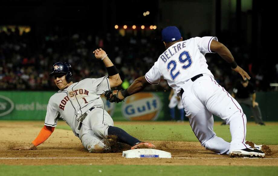 Astros rookie Carlos Correa steals third under the attempted tag of Rangers third baseman Adrian Beltre in the sixth inning of Wednesday's game in Arlington. Photo: Tony Gutierrez, STF / AP